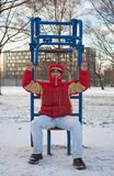 Young man exercising in winter park Stock Photos