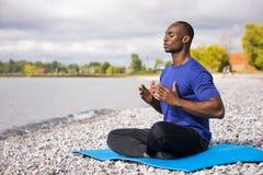 Young man exercising yoga Stock Photography