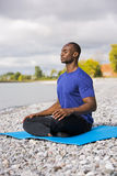 Young man exercising yoga Royalty Free Stock Images