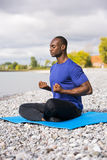 Young man exercising yoga Royalty Free Stock Image