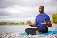 Young man exercising yoga Royalty Free Stock Photo