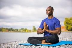 Young man exercising yoga Stock Image