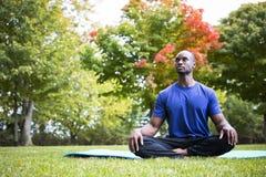 Young man exercising yoga Stock Photos