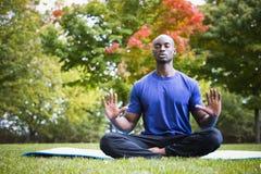 Young man exercising yoga Royalty Free Stock Photography