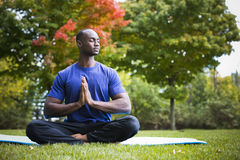 Young man exercising yoga Stock Photography