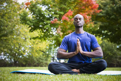 Young man exercising yoga Stock Image