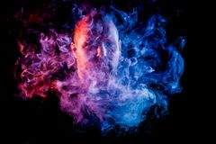 A young man exhales a cloud stock photography