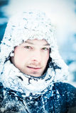 Young Man During an Expedition in the North. Young Adult man with Green Eyes During an Expedition in the North on a Freezing Winter Day Stock Photos