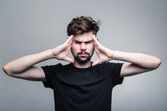 Young man is experiencing intense headache Stock Photography