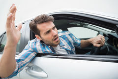 Young man experiencing road rage. In his car Stock Image