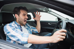 Young man experiencing road rage Stock Photography
