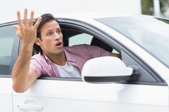 Young man experiencing road rage. In his car Royalty Free Stock Photography