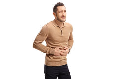 Young man experiencing stomach pain. On white background royalty free stock photos