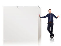 Young man explain advantages of this product, on white Stock Photography
