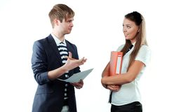 Young man explaining something to young woman Stock Photo