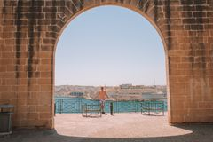 Young man exploring beautiful Valletta old town in Malta. Island near Valletta and Marsaxlokk village Royalty Free Stock Image