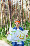 Young man is exploring the map Royalty Free Stock Photos