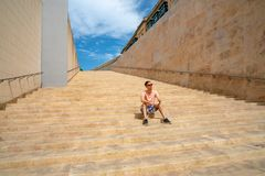 Beautiful Valletta old town in Malta. Young man exploring Very beautiful Stair in Valletta old town in Malta Stock Images