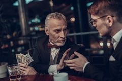 Young Man extends his hand and Old Man no rush stock images