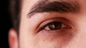 Young man eye close-up stock video footage