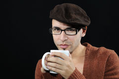 Young man with eyeglasses and cup Stock Image