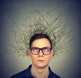 Young man having chaotic mind stock image
