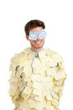 Young man with eyes painted on stickers. Covered with yellow sticky notes Royalty Free Stock Photos