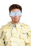 Young man with eyes painted on stickers. Covered with yellow sticky notes Royalty Free Stock Photography