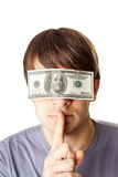 Young man with eyes sealed by a hundred dollar bills. Isolated on white background Stock Photography