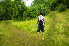 Young man facing choice between two different path Royalty Free Stock Images