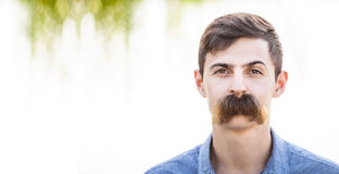 Young man with fake mustaches. Dental health concept royalty free stock photo