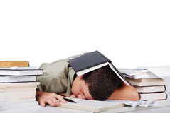 Young man fallen asleep after long reading Royalty Free Stock Image