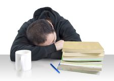 Young man fallen asleep over books Stock Photo