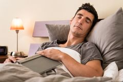 Young man falling asleep while reading Royalty Free Stock Images