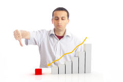 Young man with a falling chart Royalty Free Stock Photography