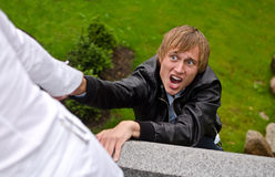 Young man falling down. From the bridge Stock Photos