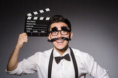 Young man with false moustache holding Royalty Free Stock Images