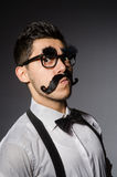Young man with false moustache Royalty Free Stock Photos