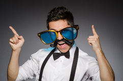 Young man with false moustache Stock Image