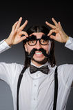 Young man with false mustache and eyebrows Stock Photos