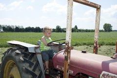 Young man at a farm vehicle stock image