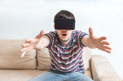Young man is fascinated from virtual reality headset Royalty Free Stock Image