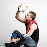 Young man in fashionable clothes Royalty Free Stock Images