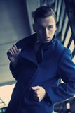 Young man in a fashionable coat Stock Images