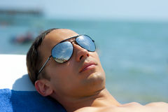 Young man in fashionable sunglasses Royalty Free Stock Images