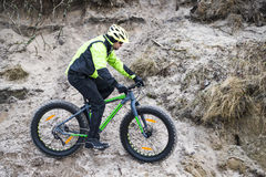 Young man on fat bike Royalty Free Stock Image