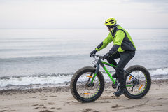Young man on fat bike Royalty Free Stock Photo