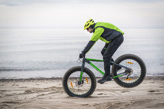 Young man on fat bike Royalty Free Stock Photos