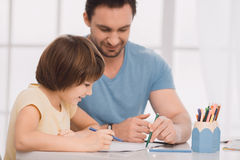 Young man father drawing with kid creativity development Stock Photos