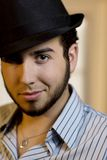 Young Man in a Fedora. Handsome Young Man Indoors Wearing a Fedora Hat stock photo